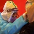 Dėl koronaviruso protrūkio trijuose miestuose Kinija testuoja milijonus žmonių